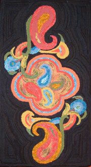 Paisley by Liz Krist. Note that the paisley shapes were punched with yarn and the  background was traditionally hooked with fabric strips.