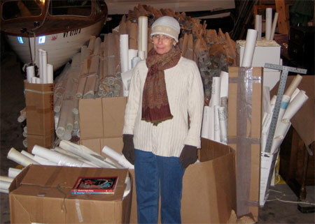 "Over 1000 patterns on rolls of paper were delivered to my barn after the auction; it took two moving vans to deliver all of these rolls. In this picture I am also feeling completely overwhelmed and thinking, ""What have I done?!"""