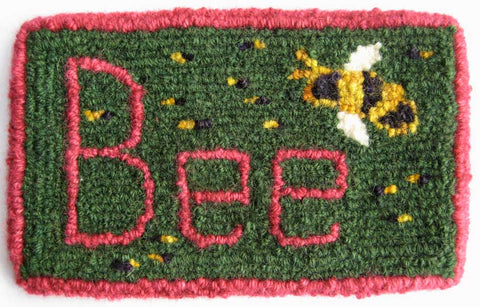 "This ""Bee Mat"" was punched using ""The Mini""  and the lettering and border were done  with ""The Mini With Heels."""
