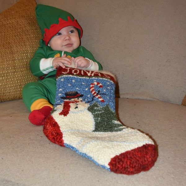 Amy Oxford's grandson Jonas holding his Snowman Stocking.