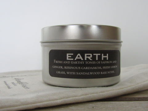 earth travel tin 6 oz. travel tin candle , pride of dakota, wood wick, soy, lemon grass, ginger, cardamon - bumble & earth candle co.