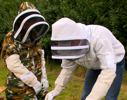 beekeeping suit and jackets in apiary
