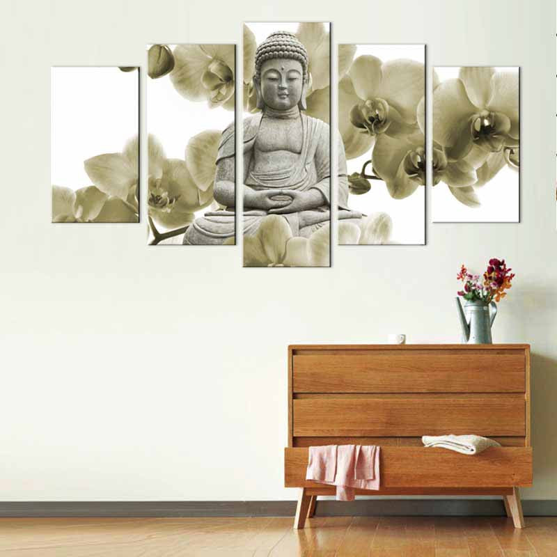Buddha Sculpture with White Orchid