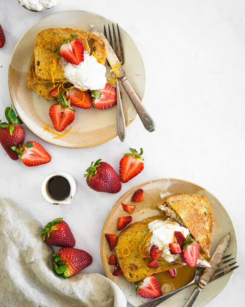 Strawberry Cream Cheese Stuffed French Toast on plates with maple syrup