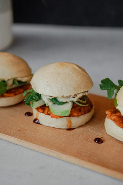 Three gluten-free, vegan sweet potato sliders made using bread srsly gluten-free sourdough dinner rolls and just date syrup