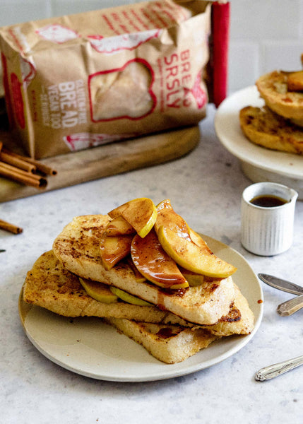 Stack of Gluten-Free, Dairy-Free Apple Pie French Toast on a plate with a side of maple syrup