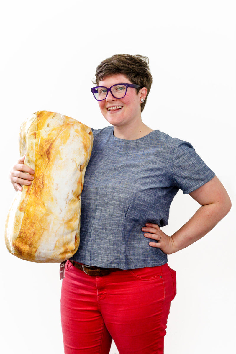 CEO and Founder, Sadie Scheffer, holding a large bread pillow