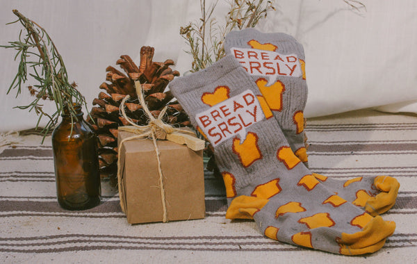 Bread SRSLY socks make a great gift, and are shown next to a wrapped gift