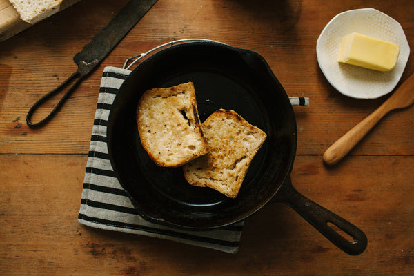 Bread SRSLY Classic Sourdough bread toasted in a skillet with butter