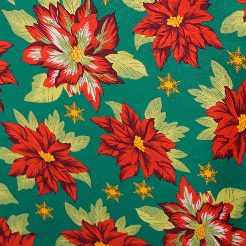 Pointsettia on Green Polyester Poplin Fabric