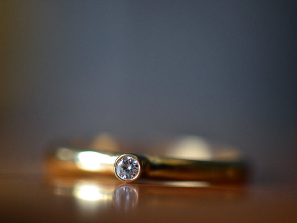 Simple Recycled 14K Yellow Gold Ring With Tiny Moissanite