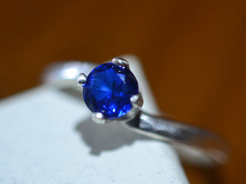 Simple Curved Silver Offset Blue Spinel Ring