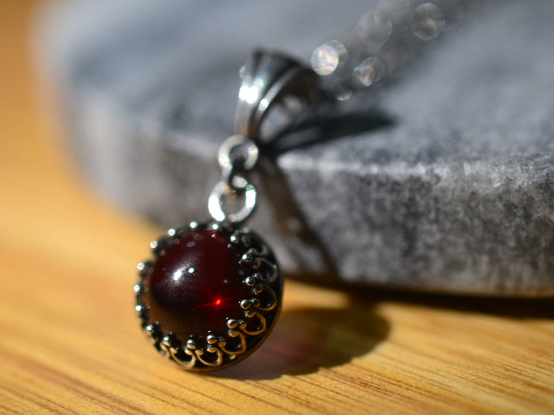 Natural Garnet Pendant in Antiqued Sterling Silver Bezel