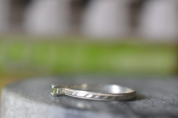 Dainty Peridot Engagement Ring in Patterned Sterling Silver
