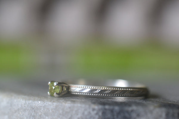 Delicate Stripe Patterned Peridot Engagement Ring in Silver