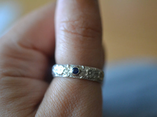 Custom Made Sterling Silver Rose Wedding Band With Blue Stone