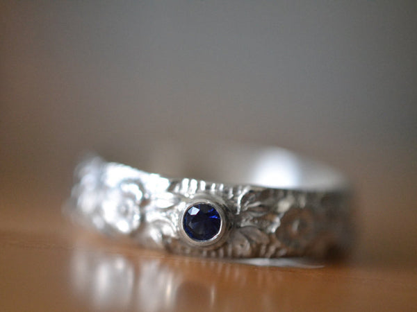 Engravable Wild Rose Wedding Ring With Tiny Blue Sapphire
