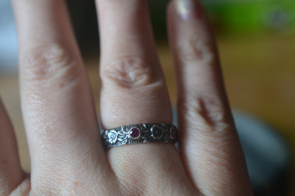 Oxidised Silver Wild Rose Wedding Band With Tiny Inset Ruby