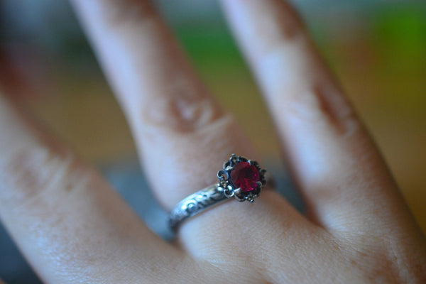 Gothic Ruby Engagement Ring With Tiny Topaz