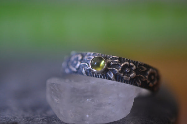Customised Peridot Gemstone Wedding Band With Wild Roses