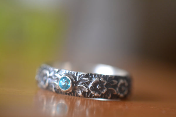 Oxidised Silver Rose Wedding Band With Tiny Blue Topaz