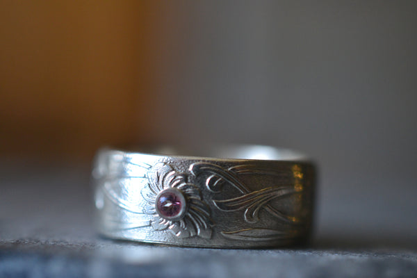 Men's Wide Silver Floral Wedding Band With Tiny Pink Stone