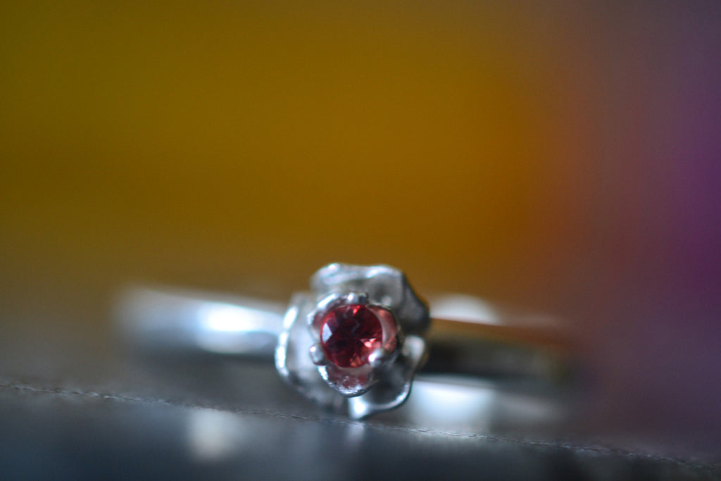 Sterling Silver Flower Ring With Tiny Red Sapphire