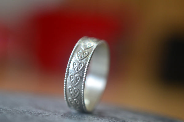 Custom Made Wedding Band in Sterling Silver With Heart Pattern