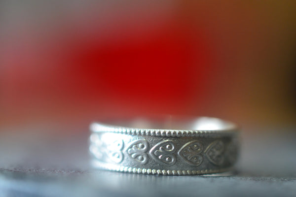 Lightweight Sterling Silver Wedding Band With Heart Motif