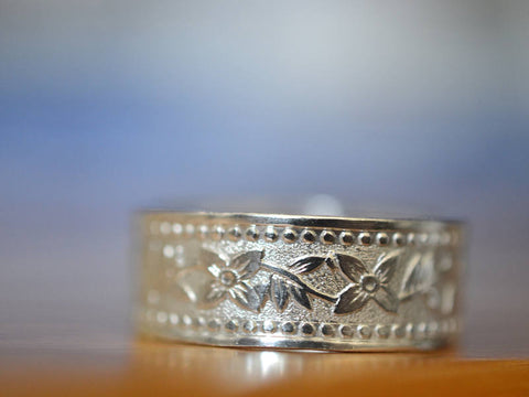 Men's Repeating Flower Wedding Band in Sterling Silver