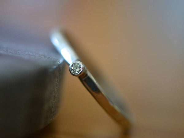 Tiny Moissanite Ring in Sterling Silver