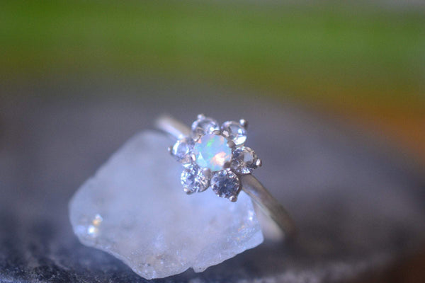 Vintage Style Opal Engagement Ring With White Sapphire Cluster