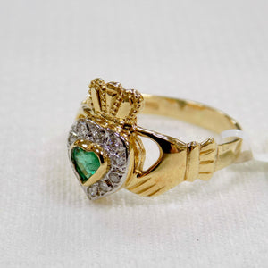 side view of ladies gold Claddagh ring with emerald and diamonds