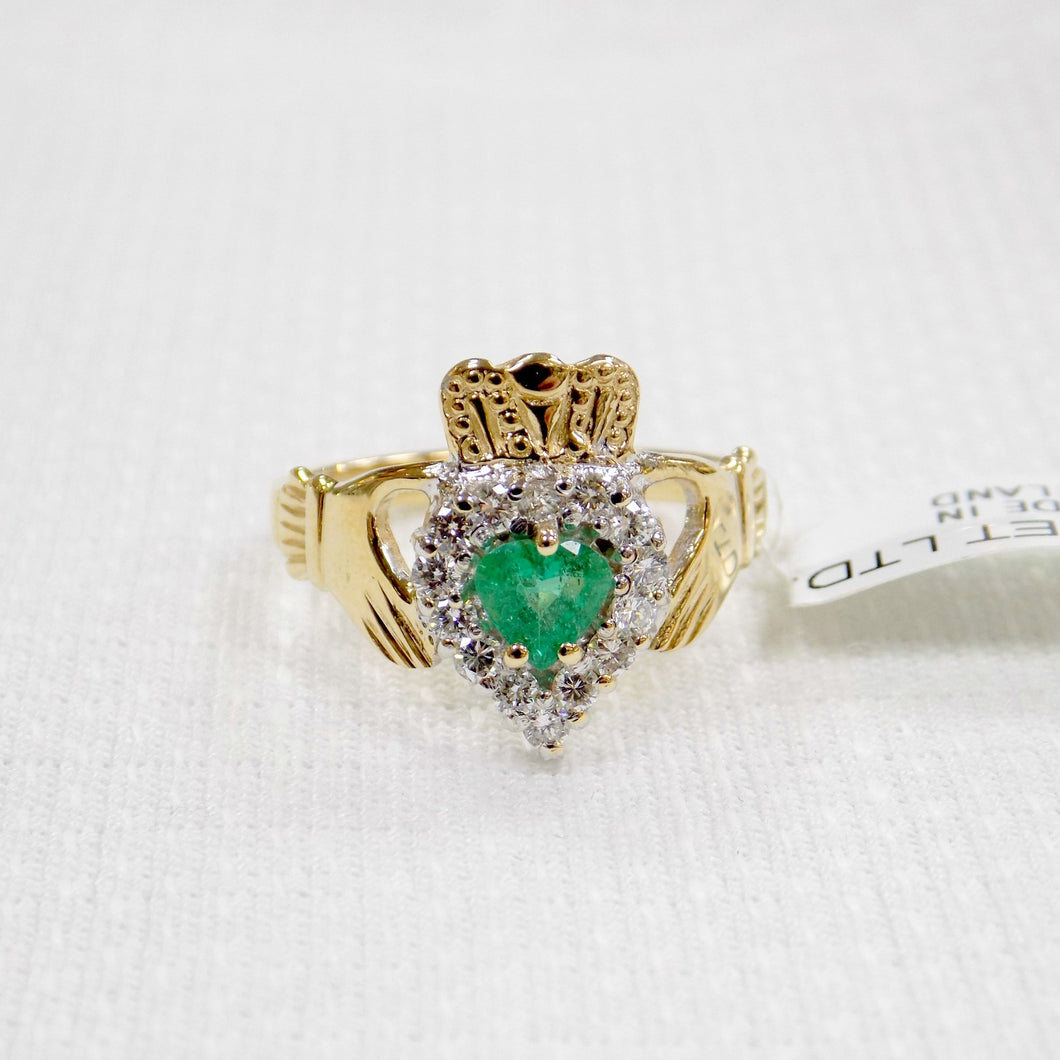 Irish made gold Claddagh ring with emerald and diamond