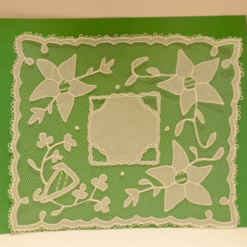 Handmade Carrickmacross lace with flowers and harp.