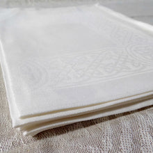 Load image into Gallery viewer, White Irish linen placemat with celtic weave