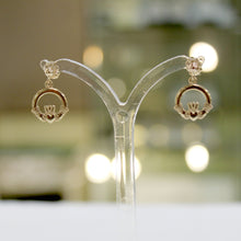 Load image into Gallery viewer, Dangling Gold Claddagh Earrings