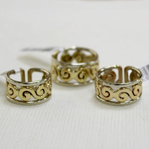 Celtic style rings with swirl design