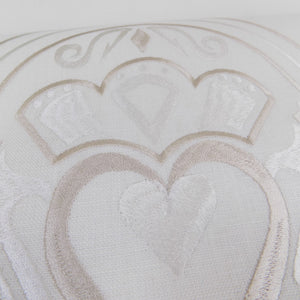 detail of irish linen runner with gold claddagh design