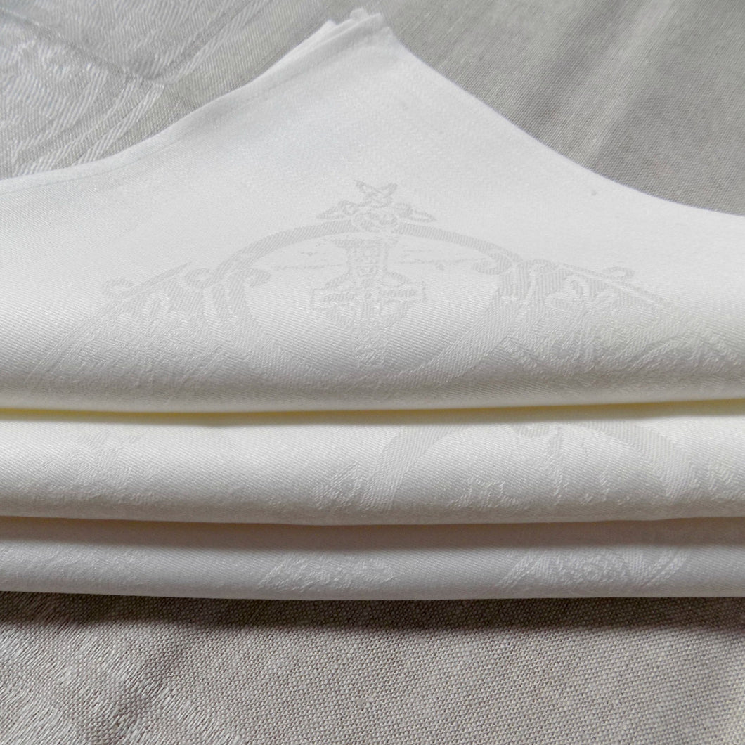 folded white Celtic Irish linen napkins
