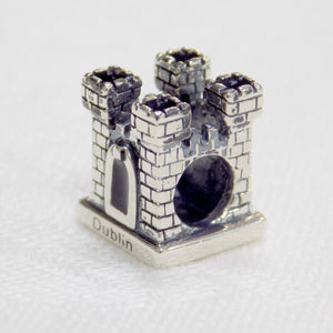 A castle shaped sterling silver bead charm