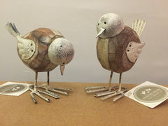 Wooden birds with wire feet