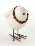 White bird with a garland round its neck