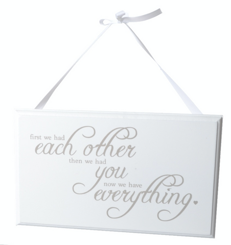 First we had each other, wooden slogan sign