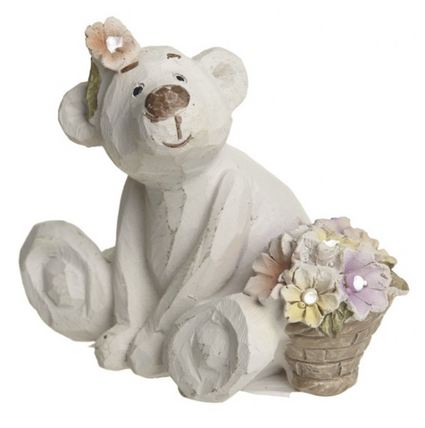 Fleur Bear, the botanist, sitting with flowers