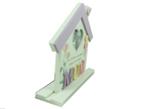 Side view of freestanding floral style house photo frame / plaque