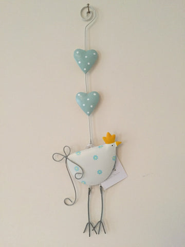 White and blue hanging metal chicken