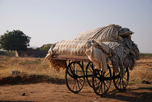 Ajrakh cloth loaded on a cart ready for dyeing