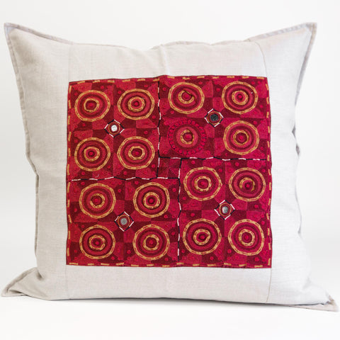 Banjara cushion cover hand embroidered red and gold on natural linen by Maiwa