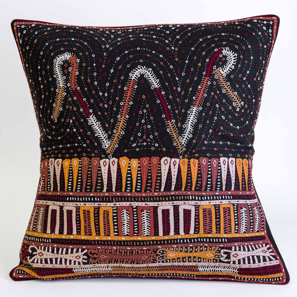 Dhebria Rabari Embroidered cushion cover brown, gold, peach on black linen by Maiwa
